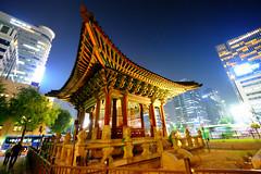 Temple in Seoul, South Korea (` Toshio ') Tags: toshio seoul korea southkorea temple ancient monument skyscraper night people asia fujixe2 xe2
