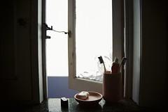 Morning Essentials (Luke Jacob Simon) Tags: 35mm kodak ultramax canon ae1 ishootfilm filmisnotdead glebe sydney vignette dark bathroom perspective shadow interior vintage window toothpaste documentary