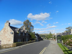 Welcome to Conon Bridge, Black Isle, Oct 2016 (allanmaciver) Tags: conon bridge black isle weather warm clouds central traditional slope bus stop yellow lines curve village community scotland allanmaciver