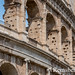 Rome, Italy- View of the famous stone amphitheater known as the Roman Colosseum located east of the Roman Forum. Officially known as the Flavian Amphitheater, it was commissioned by Emperor Vespasian as a gift to the Roman people. Gladiatorial combats and