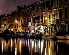 Lights and Music on Venice's Canals (filippogatteschi) Tags: canal venice urbanlandscape urban landscape nightshooters nightphotography nightlife venezia people townsfolk live music acoustic riverside nightshow longexposure canoneos70d tamron2470 handheld photography italy tourism travel beauty art reflections architecture buildings houses pianobar detail frame color water boats lamplights streetlights cozy atmosphere livemusic canon balcony windows summer river warmth