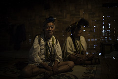 two old man of the niyshi tribes wearing the traditional head-dress having a hornbill beak, arunachal pradesh (anthony pappone photographer) Tags: travel portrait india wearing canon spirit traditional oldman hut ritratto along shaman headdress arunachal nishi tribesman capanna arunachalpradesh animist ziro daporijo animisti bucero hornbillbeak niyshi nishitribe donyipolo niyshitribe