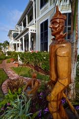 Tin Man, Galveston (Erik Pronske) Tags: wood house man galveston home car tin texas oz wizard district victorian carving historic voigtländer12mm