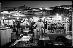 Marrakech_120213_0473 (Steve Bark) Tags: africa street people bw food white black cooking night 35mm mono evening fuji market north stall pot morocco marrakech souk marrakesh grayscale greyscale xpro1