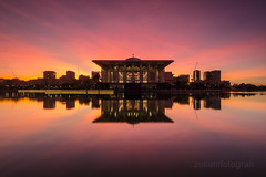 Insatiable (zollatiff) Tags: morning travel sky lake reflection building water colors architecture clouds sunrise buildings landscape twilight nikon scenery ray cityscape horizon structures peaceful mosque calm harmony malaysia serene putrajaya tranquil federalterritory zollatif