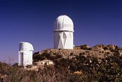 The Telescopes of Kitt Peak (Radical Retinoscopy) Tags: arizona mountain film analog 35mm photography fuji desert minolta tucson az bluesky observatory telescope velvia astronomy polarizer telescopes fujichrome kittpeak minoltasrt kittpeaknationalobservatory 50mmf12 azhighways fujichromervp100velvia