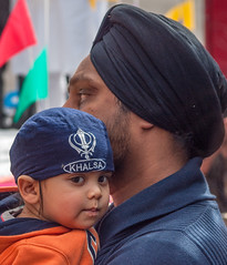 A little Sikh boy and his father at the 2013 Vaisakhi festival parade in Southampton (Anguskirk) Tags: uk england color colour festival hampshire procession sikh gurdwara southampton turbans saris khalsa vaisakhi 2013 nagarkirtan gurdrawananaksar
