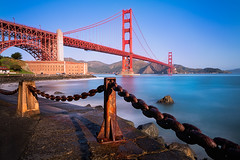 Rusty Surf (Sairam Sundaresan) Tags: ocean sanfrancisco longexposure bridge blue red sea sky cliff usa sun white seascape color colour water colors lines rock architecture sunrise canon point coast chains rust san long surf waves glow colours fort decay iii curves shapes dramatic sunny wideangle cliffs textures goldengatebridge shore goldengate waters 5d fortpoint canon5d lowtide oceans feb shores seashore presidentsday luminosity sairam canon5dmarkiii 5dmarkiii thepinnaclehof kanchenjungachallengewinner sairamsundaresan tphofweek201