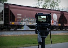 Fishing and benching are so much alike (builder24car) Tags: railroad graffiti perspective northcarolina trainart freighttraingraffiti paintedboxcar benchingthefreights
