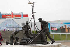 London_2012_ExCel_Front_Paralympics_Dockers_Statue_E1_4724 (Firing Canon) Tags: london sign banner entrance signage 2012 excel paralympics london2012 livery paralympic paralympicgames locog competitionvenue paralympicagitos dockersstatue