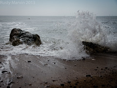 Overcast, dull and raining (Rusty Marvin (Going around the pole)) Tags: england rock stone rocks surf day stones wave spray isleofwight splash dull backwash freshwater