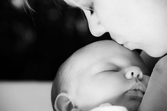 Mothers Kiss (Ryan Arneson) Tags: family baby white black love mom photography kid hug infant kiss child emotion affection daughter mother warmth newborn cuddle