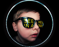 A New Way (Victoria Hederer Bell) Tags: boy portrait distortion silly sunglasses lensbaby kid funny distorted flash helmet fisheye round ringflash strobe composer victoriahedererbell