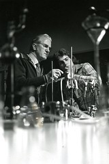 Dr. Vernon Winn and student (PUC Special Collections) Tags: laboratory lab pacificunioncollege chemistrydepartment chemistrylab chemistry beakers test tubes scientist labcoat experiments angwin california adventist sda seventhdayadventist college