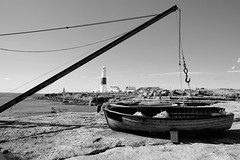 Boats at Portland (Rob Hall -) Tags: bwartaward boat boats seafront sea seaside coastline coast coastal bright sunny sunshine sunlight sun blue crane hoist rock cliff portlandbill uk england hook chain cable lighthouse blackwhite