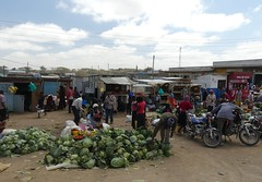 Open Air Markets (janetfo747 ~ Thank You for the Views and Comments) Tags: african tanzania village smalltowns life culture daylight dress customs memories highlights ethnic culturaldiversity work herds water walk truckin shops stores donkeys houses cabbage selling veggie motorcycles taxis