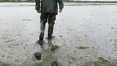 Mud explorer in action! (essex_mud_explorer) Tags: bullseye hood bullseyehood madeinchina rubber wellington boots wellingtons wellingtonboots wellies welly rubberboots gummistiefel gumboots rainboots rainwear rubberlaarzen mud muddy mudflats creek estuary tidal barling wakering little essex camotrousers camouflage raincoat rainjacket waterproof