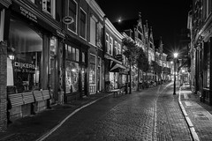 Street light (McQuaide Photography) Tags: haarlem noordholland northholland netherlands nederland holland dutch europe sony a7rii ilce7rm2 alpha mirrorless 1635mm sonyzeiss zeiss variotessar fullframe mcquaidephotography lightroom adobe photoshop tripod manfrotto light licht night nacht nightphotography stad city urban lowlight architecture outdoor outside illuminated street straat warmoesstraat shoppingstreet window wideangle wideanglelens groothoek building longexposure blackandwhite blackwhite bw mono monochrome atmosphere cobblestone cobbledstreet oldstreet old oud character traditional authentic streetlight lantaarnpaal