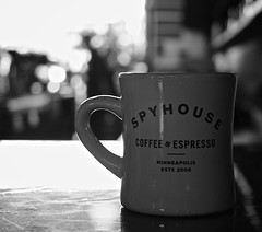 Spyhouse Coffee (clint mcmahon) Tags: blackandwhite cup coffee minnesota coffeecup minneapolis coffeeshop uptown mpls spyhouse canonefs18135mmf3556isstm