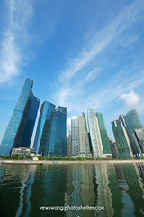 Singapore City Skyline 06 (yewkwangphoto) Tags: sea cloud seascape tourism water horizontal architecture landscape singapore asia cityscape bluesky tourist hotels banks skyscaper famouslandmark commercialbuilding placeofinterest modernbuildings modernstructure buildingstructure singaporecityskyline photocategory yewkwang photographybyyewkwang
