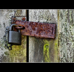 Deterrent (Prestidigitizer) Tags: door wood old moss rust lock antique decay victoria decrepit padlock latch hasp pentaxk10d platinumheartaward pentaxda50135mm mygearandme dblringexcellence tplringexcellence photographyforrecreation