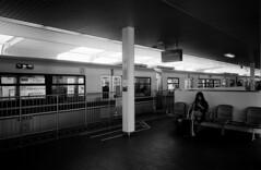 (flaxendream) Tags: 35mm film ricohgr1v ilfordhp5 analog blackandwhite bw monochrome train monorail japan osaka woman travel