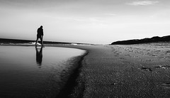 Beach Walk (Dan-Schneider) Tags: blackandwhite bw best beach schwarzweiss schneider scene sea walk moment mft monochrome minimalism mirror mood man reflection prime lens light olympus omdem10 trip travel step sky silhouette nature einfarbig silence lonliness solitude street streetphotography people photography puddle puddlegram