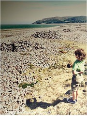 Waiting... (Orchids love rainwater) Tags: grandson henry beach cliffs pebbles sea brauntoncroyde devon sky thinking waiting shadow rocks one