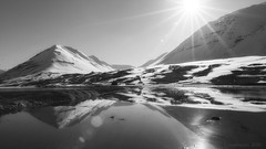 my mind keeps roaming these shores (lunaryuna) Tags: iceland northiceland olafsfjordur landscape fjord mountainrange water shore coast reflections seeingdouble winter season seasonalbeauty wintersun sunshine sunflares boggrass snowtoppedmountains beautifullight lunaryuna panoramicviews blackwhite bw monochrome