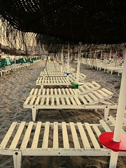 Line of hammocks beach (Cris__CG) Tags: benalmádena hammocks hamacas playa beach mar sea marrón brown sombrillas sunshadows arena sand white blanco costadelsol