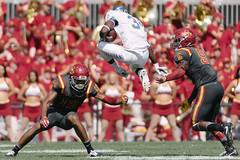 College football player jumps to avoid tackle - [Explored] (Q Win) Tags: ncaaf ncaa big12 tackle avoid hurdle jump cy cyclone jose san sport college american university state iowa football outdoor