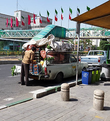 Offloading (Kombizz) Tags: 111135 kombizz tehran iran 2016 1394 mobilephonetaking mobilephonecapture offloading van greenfood sabzi iranianflags 13e121 boxesofpeaches bagsofcarrots boxesoforanges boxesoffruits vegetables footbridge polehavaee district9 concretebollards
