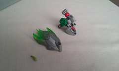 Keeper's Head How-to  Step 10 (ohlookitsanartist) Tags: keeper dragon shrine lego bionicle howto step stepbystep silver green build jaw head noggin technic pieces instructions