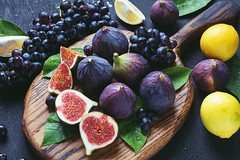 Fresh figs, grapes and lemons (Arx0nt.) Tags: figs food fresh fruit grapes grapevine grow harvest health healthy ingredient juicy natural nature nutrition organic plant purple red ripe seasonal sweet table tasty texture tropical vine violet vitamins viticulture white winery wood autumn summer background lemons yellow leaf bunch berries abundance
