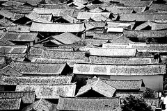 Distinctive sloping tiled roofs of Lijiang Old Town 1995 (Bruce in Beijing) Tags: china history architecture culture tiles yunnan lijiang ethnology nakchi roofdesign preearthquake