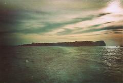 island blues (TIBBA69) Tags: old sea sky film clouds analog vintage island nuvole mare colours kodak scratches retro cielo dust colori yashica analogica isola polvere graffi fx3 islandblues andreatiberini