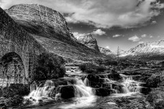 The Russel Burn and The Bealach na Ba (emperor1959 www.derekbeattieimages.com) Tags: pictures winter wild sky mountain snow nature beautiful landscape scotland waterfall highlands russel na burn ba rugged bealach