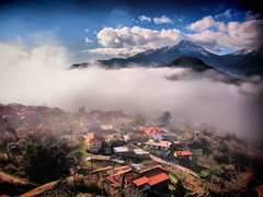 Revelation (jimiliop) Tags: morning houses light sky sun snow mountains weather misty fog clouds landscape countryside village apocalypse greece plain vignette tops revelation corinthia feneos goura mygearandme