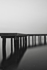 Misty Morning (headcycle) Tags: morning blackandwhite bw white seascape black reflection water clouds sunrise canon pier boat dock long exposure angle nd density neutral