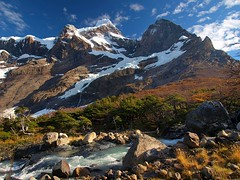 Paine Grande (World Traveller Photography) Tags: chile blue autumn trees sky patagonia mountain snow cold ice southamerica clouds forest trekking river colours hiking torresdelpaine