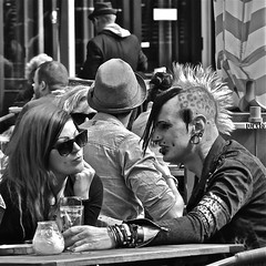 Punk isn't Dead (Akbar Simonse) Tags: street boy people urban bw woman man holland blancoynegro girl monochrome square punk zwartwit candid nederland streetphotography denhaag shades tattoos mohawk piercings thehague grotemarkt straat zonnebril hanekam straatfotografie dedoka akbarsimonse