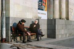 Men chatting at Republic Square (lightmagic) Tags: armenia street color republic square old elderly bench columns winter cold hats sitting conversation friends men