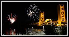 Fireworks_4952 (bjarne.winkler) Tags: river cats 2016 no 11 fireworks 12  standard view from walk embassy suits with tower bridge foreground calstrs building background welcome sacramento ca