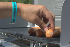 rainbow trout hot dog hand (Justin van Damme) Tags: rainbow trout hot dog hand festival music blue teal wristband coleman grill smokie cooking camping stove