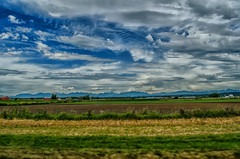 Heading to Town (Martin Smith - Having the Time of my Life) Tags: headingtotownhwy99 nikkor1855mmf3556gvrii nikond7000 martinsmith martinsmith delta northshoremountains fields landscape farmersfields dramaticclouds clouds