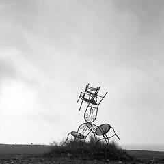 Chaireography (DanRSmith) Tags: bw blackandwhite monochrome chairs sculpture beach hastings oldtown stade rolleiflex xenotar 35e kodaktrix rodinal