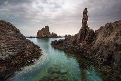 E Piú Ti Penso (MANUELup) Tags: sky water blue light clouds cloudy movement summer calm green seascape stone lonely seashore waterscape naturallight quite formation rocks spain sea andalucía almería cabodegata gata