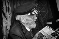 """Steam Professional"" (Mister Oy) Tags: davegreen oyphotos oyphotos mono monochrome blackandwhite people eastlancsrailway railway reader reading hat fujixpro2 fuji55200mm"