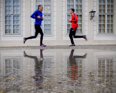 Synchronous Running (CoolMcFlash) Tags: puddle runner jogger synchronous synchron step water street streetphotography blue red sport vienna fujifilm x30 rain facade pftze running jogging laufen lufer funny lustig timing moment candid gleichzeitig schritt wasser blau rot person people jacket jacke regen fassade fotografie photography reflection reflektion reflexion spiegelung men mann man outdoor imfreien motion blur bewegung bewegungsunschrfe