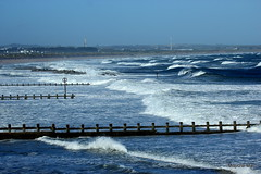 Blue beach (mootzie) Tags: frothwhite sea beach blue waves sky groynes white breezy aberdeen scotland
